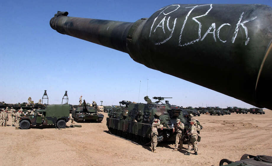 A hand written message adorns a U.S Marine M1A1 Abrams tank's barrel as preparations for possible action in Iraq continue at a Marine support camp February 5, 2003 near the Iraqi border in Northern Kuwait. During a brief stopover as part of a regional tour, the Commandant of the U.S. Marine Corps, General Michael Hagee spoke with troops about the need to be prepared in case U.S. President George W. Bush orders the Marines to action in neighboring Iraq. Photo: Scott Nelson, Getty Images / 2003 Getty Images