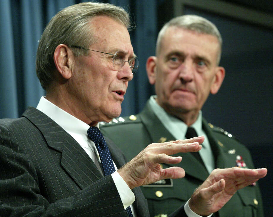 U.S. Secretary of Defense Donald Rumsfeld (L) and General Tommy Franks, Commander of Central Command, attend a news briefing March 5, 2003 at thePentagon in Arlington, Virginia. They spoke about U.S. war plans if there is a military attack on Iraq and the DOD's plan to hit Iraq with a heavy air campaign in the opening days of an attack. Franks will lead the American forces if there is a war with Iraq. Photo: Alex Wong, Getty Images / 2003 Getty Images