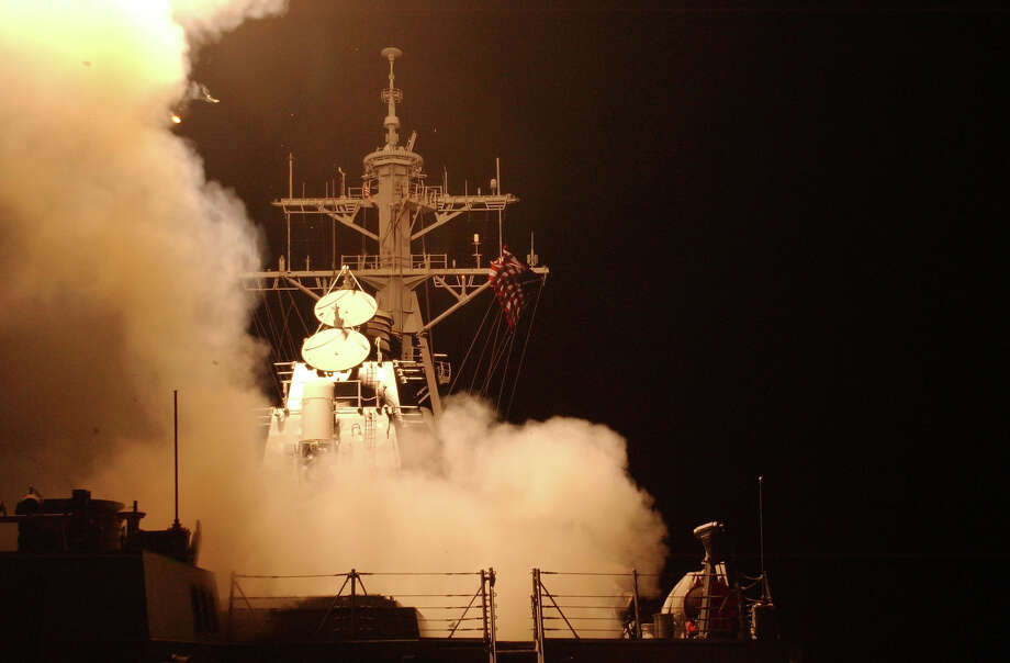 Tomahawk Land Attack Missiles (TLAM) launch from the ship's forward and aft MK-41 vertical launch systems (VLS) aboard the guided missile destroyer USS Donald Cook March 20, 2003 in the Red Sea. The cruise missiles were among the first to be fired in support of Operation Iraq Freedom. Photo: U.S. Navy, Getty Images / 2003 Getty Images