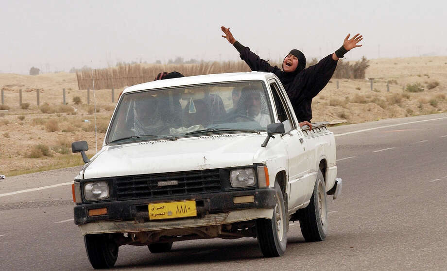 An Iraqi woman, with two dead relatives in the car, screams while pulling up to a British check point March 22, 2003 north of the city of Safwan, Iraq. British and American troops have moved into Iraq commencing the 'broad and concerted campaign' that President George W. Bush has been talking about. Photo: Spencer Platt, Getty Images / 2003 Getty Images