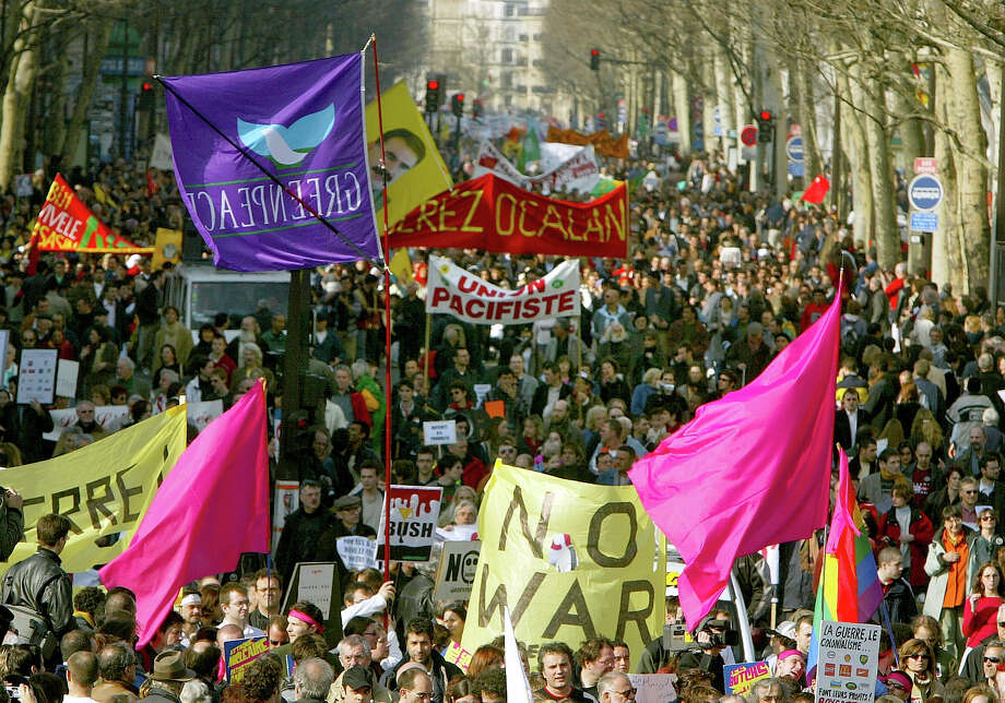 Thousands of anti-war demonstrators march through the streets during an anti-war rally against the U.S.-led war on Iraq March 22, 2003 in Paris, France. Photo: Pascal Le Segretain, Getty Images / 2003 Getty Images
