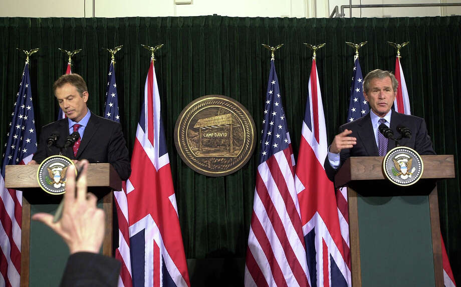 President George W. Bush and British Prime Minister Tony Blair speak during a news conference at Camp David following their talks on the progress of the war in Iraq March 27, 2003 in Thurmont, Maryland. Photo: Pool, Getty Images / 2003 Getty Images