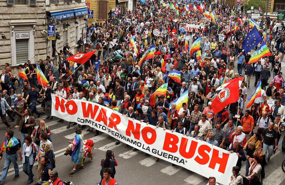 People demonstrate against the the Iraq war and U.S President George W.Bush June 4, 2004 in Rome, Italy. About 150,000 people took part in the demonstration during the first day of Bush's three day visit to Europe. Photo: Marco Di Lauro, Getty Images / 2004 Getty Images
