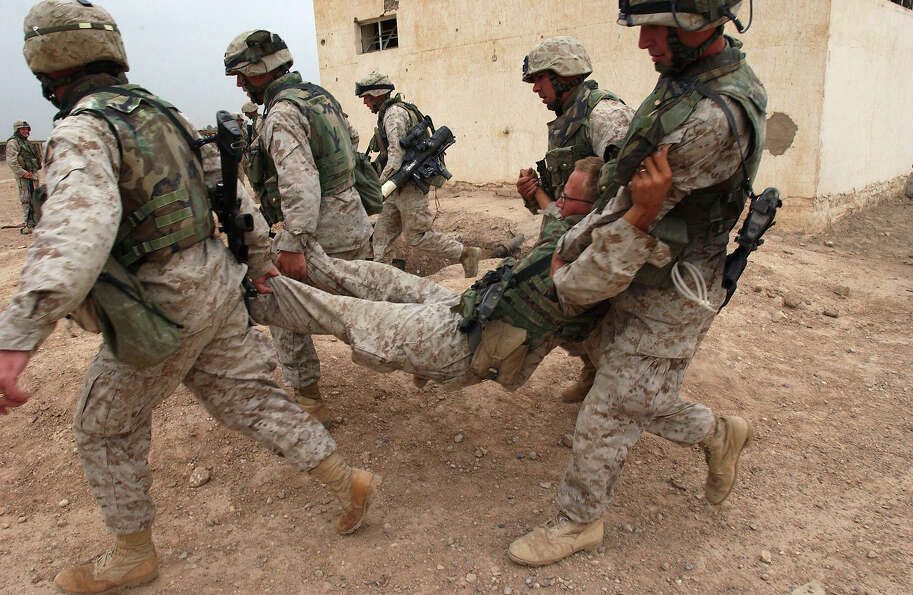 U.S Marines from the 1st Expeditionary Force train for urban combat at their base October 31, 2004 n