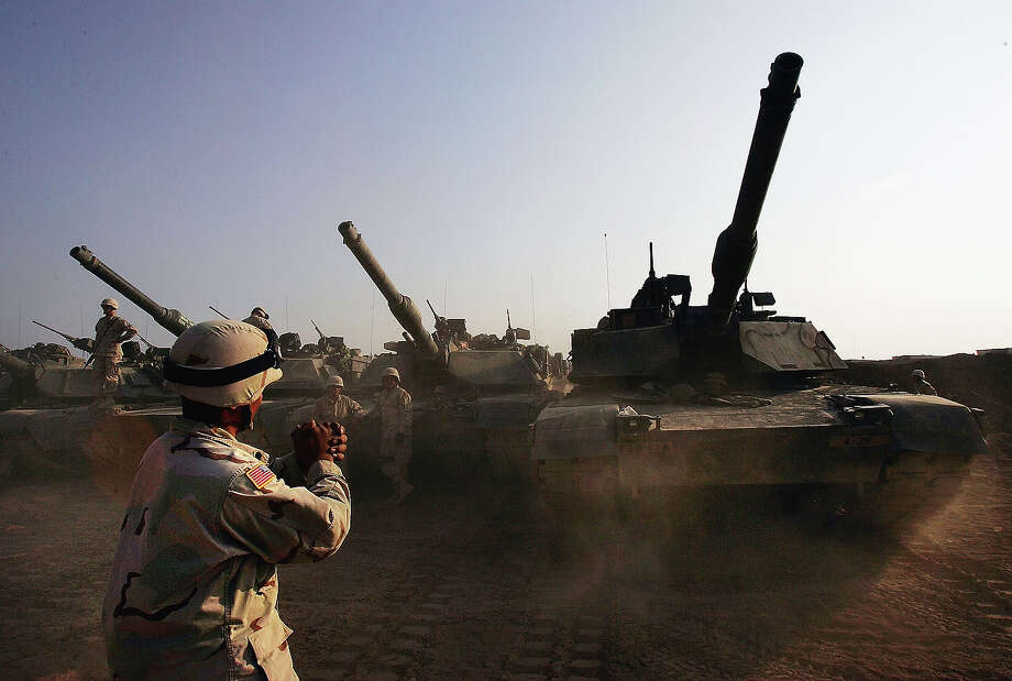 U.S. Army tanks are moved into a base, on November 4, 2004 on the outskirts of Falluja, Iraq. Several thousand U.S. troops are poised for a massive strike near the restive Suni and insurgent stronghold of Fallujah, and Iraqi President Allawi has warned that negotiations with local insurgents to reach a peaceful solution have nearly run their course. Photo: Scott Nelson, Getty Images / 2004 Getty Images