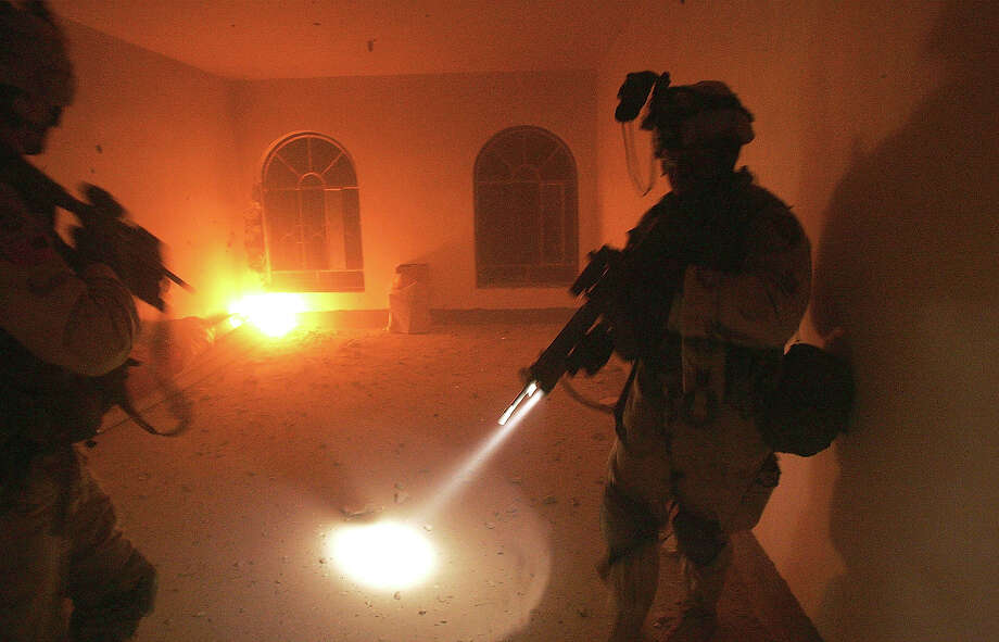 U.S. Army soldiers from the 1st Infantry Division's 2nd Battalion-2nd Regiment sweep through an abandoned home during heavy fighting November 9, 2004 in the insurgent stronghold of Fallujah, Iraq. On the authority of Interim Prime Minister Ayad Allawi, US and Iraqi forces are currently engaged in a battle to take back control of the city ahead of planned nationwide elections in January. Photo: Scott Nelson, Getty Images / 2004 Getty Images