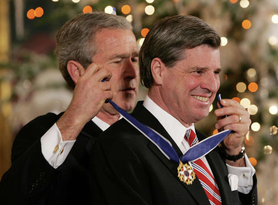 U.S. President George W. Bush awards the Presidential Medal of Freedom to Paul Bremer (R), former administrator for the Coalition Provisional Authority in Iraq, in the East Room of the White House December 14, 2004 in Washington DC. The Presidential Medal of Freedom is the nation's highest civil honor. It is awarded by the U.S. President to people who have made contributions to the security or national interests of the U.S., to world peace, or to cultural endeavors. Photo: Win McNamee, Getty Images / 2004 Getty Images