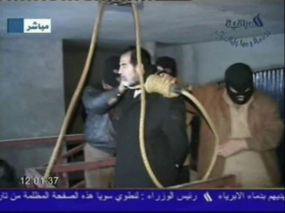 In this television screen grab taken from Iraqi national television station Al-iraqia, a video shows the moments leading up to the execution of former Iraqi dictator Saddam Hussein as he is prepared for hanging and the noose is put over his head on the gallows, on December 30, 2006 in Baghdad, Iraq. The former Iraqi president was executed by hanging at 0600 (0300 GMT) in a secure facility in the Northern Baghdad suburb of Khadimeya. Photo: Handout, Getty Images / 2006 Al-iraqia