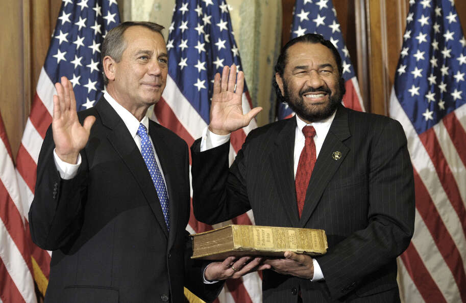 House Speaker John Boehner of Ohio, left, performs a mock swearing in for Rep. Al Green, D-Texas, Th