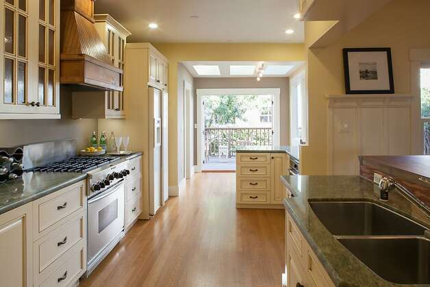 French doors open to the patio and create a larger living space. Photo: Trevor Henley, Henley Photography