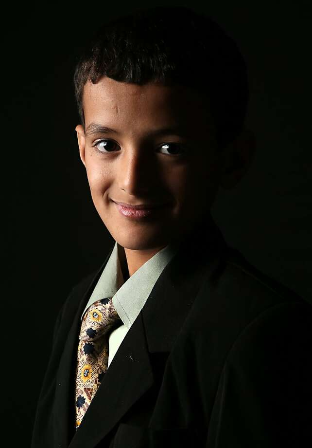 Issa Nasher, 12, who's family immigrated from Yemen to Newburgh, NY, awaits his American citizenship certificate at the U.S. Citizenship and Immigration Services (USCIS), office on February 19, 2013 in New York City. Photo: John Moore, Getty Images