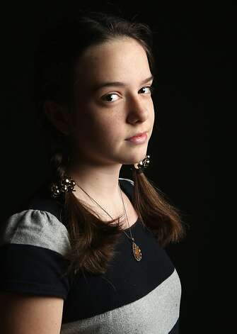 Eighth grade student Anastasiya Varanetskaya, 13, born in the Ukraine, waits to receive her citizenship certificate at the U.S. Citizenship and Immigration Services (USCIS), office on February 19, 2013 in New York City. Her mother, naturalized American citizen Nataliya Varanetskaya, is a medical professional, and their family lives in Brooklyn. Photo: John Moore, Getty Images