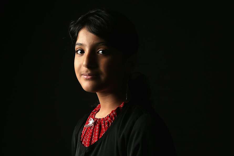 Layla Hussain Nasher, 11, who's family immigrated to Newburgh, NY from Yemen, awaits her U.S.