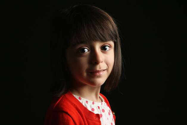Olivia Braddock, 4, who was born in Armenia, awaits her U.S. citizenship certificate at the U.S. Citizenship and Immigration Services (USCIS), office on February 19, 2013 in New York City. Photo: John Moore, Getty Images