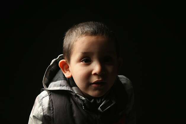Hamou Mohammed Amer, 4, born in Algeria, waits to receive his American citizenship certificate at the U.S. Citizenship and Immigration Services (USCIS), office on February 19, 2013 in New York City. His father, a naturalized American, works as a taxi driver in Brooklyn, New York City. Photo: John Moore, Getty Images