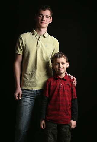 High school senior Denis Dikarev, 17, stands with his third grade brother Timothy Dikarev, 8, while they wait for their citizenship certificates at the U.S. Citizenship and Immigration Services (USCIS), office on February 19, 2013 in New York City. The brothers were born in Russia and their father, Alexy Dikarev, a naturalized American from Russia, is a maintenance worker. The family lives in Brooklyn. Photo: John Moore, Getty Images