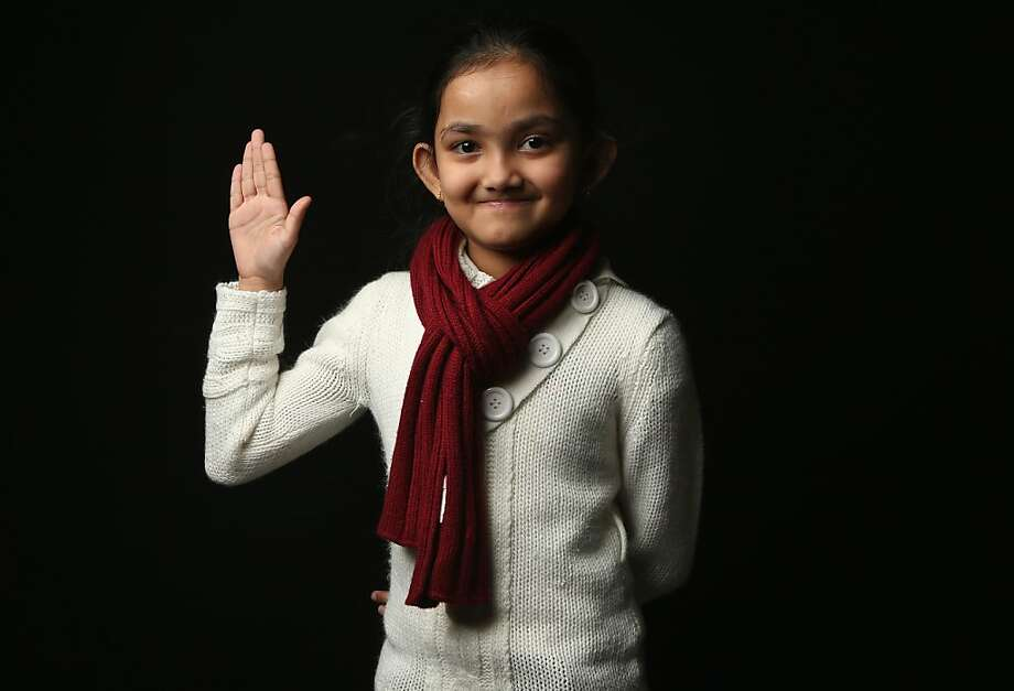 Neswima Akter, 9, who immigrated with her parents from Bangladesh to Brooklyn, awaits her American citizenship certificate at the U.S. Citizenship and Immigration Services (USCIS), office on February 19, 2013 in New York City. Her father, Zamal Uddan, is a construction worker. Photo: John Moore, Getty Images