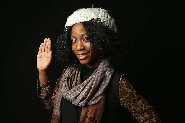 Bushra Salawu, 18, born in Nigeria, prepares to take the oath of allegiance to the United States at the U.S. Citizenship and Immigration Services (USCIS), office on February 19, 2013 in New York City. The 12th grade student at the Bronx Preparatory Charter School and daughter of a teacher said she moved from Nigeria to the Bronx, New York City, in 2000. Photo: John Moore, Getty Images