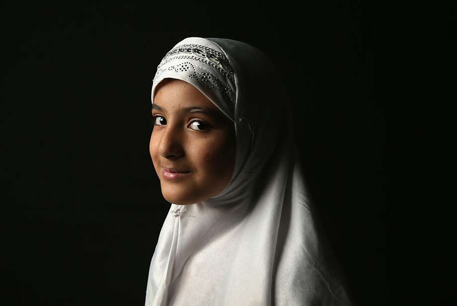 Layla Hussain Nasher, 11, who's family immigrated from Yemen to Newburgh, NY awaits her U.S. citizenship certificate at the U.S. Citizenship and Immigration Services (USCIS), office on February 19, 2013 in New York City. Photo: John Moore, Getty Images