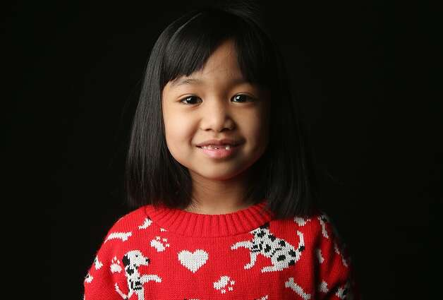 First grader Angelica Kudsi, 7, born in the Philippines, waits for her American citizenship certificate at the U.S. Citizenship and Immigration Services (USCIS), office on February 19, 2013 in New York City. Her mother, a naturalized American citizen, works as a registered nurse, and they live in Yonkers, New York. Photo: John Moore, Getty Images
