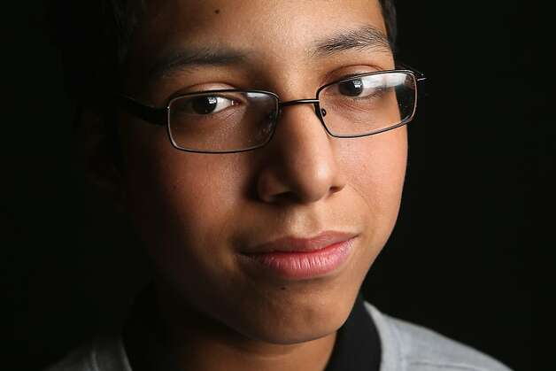 Eighth grade student Carlos Hernandez, 13, born in Peru, waits to receive his citizenship certificate the United States at the U.S. Citizenship and Immigration Services (USCIS), office on February 19, 2013 in New York City. His mother, Sisi Hernandez, a naturalized American citizen from Peru, is a domestic worker and the family lives in Queens, New York City. Photo: John Moore, Getty Images
