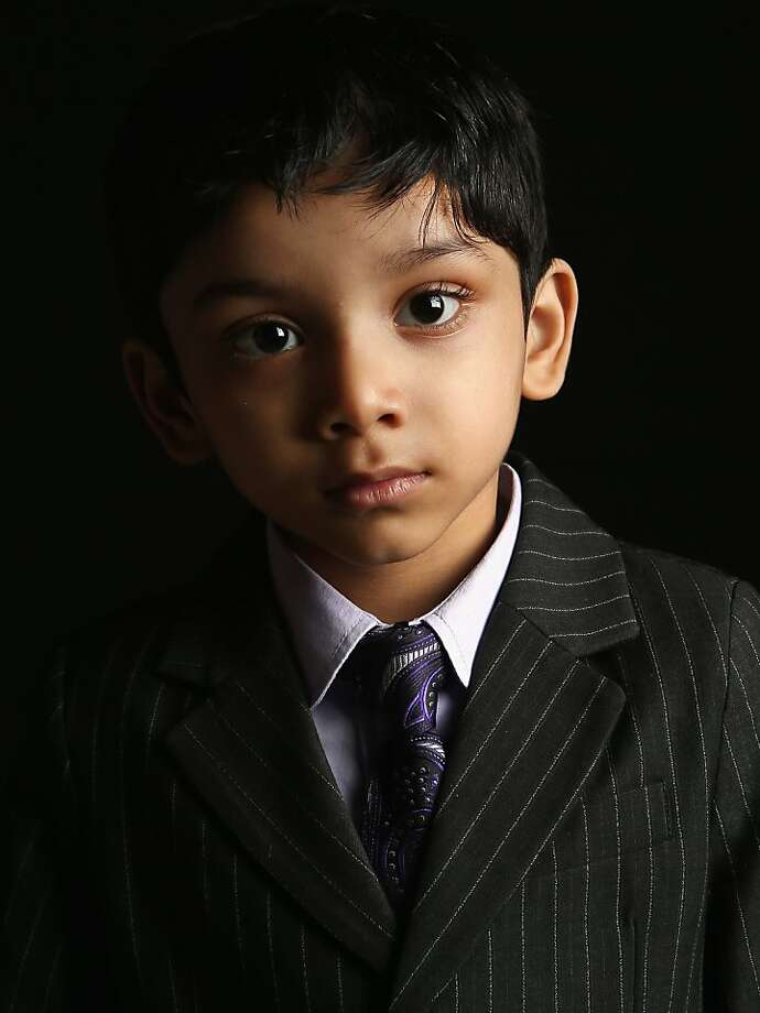 NEW YORK, NY - FEBRUARY 19:  Wahid Rashid, 4, born in Bangladesh, waits to receive his citizenship certificate at the U.S. Citizenship and Immigration Services (USCIS), office on February 19, 2013 in New York City. His father, naturalized American citizen Hamidur Rashid, is a software engineer and their family lives in Manhattan, New York City. Almost 300 foreign-born children of naturalized Americans received citizenship certificates Tuesday at the USCIS center during the special event. Children of naturalized immigrants receive U.S. citizenship if they arrive to the United States as minors, but they must go through a process at USCIS to receive official citizenship documents proving they have become Americans.  (Photo by John Moore/Getty Images) Photo: John Moore, Getty Images