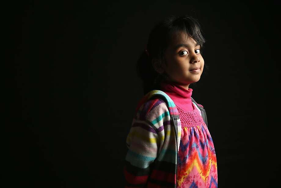 Haadiya Adnan, 5, born in Pakistan, waits to receive her citizenship certificate at the U.S. Citizenship and Immigration Services (USCIS), office on February 19, 2013 in New York City. Her father, a naturalized American from Pakistan, Adnan Chaudry, is a taxi driver, and the family lives in Brooklyn, New York City. Photo: John Moore, Getty Images