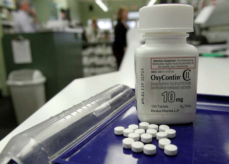 OxyContin pills are arranged for a photo at a pharmacy in Montpelier, Vt. on Tuesday, Feb. 19, 2013. Drug overdose deaths rose for the 11th straight year, federal data show, and most of them were accidents involving addictive painkillers despite growing attention to risks from these medicines. As in previous recent years, opioid drugs — which include OxyContin and Vicodin — were the biggest problem, contributing to 3 out of 4 medication overdose deaths. Photo: Toby Talbot