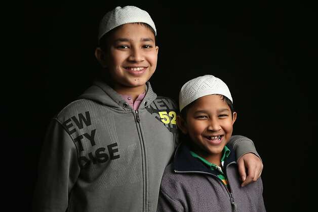 Seventh grader Mohammed Tamim, 12, and his first grade brother Mohammed Talha, 6, both from Bangladesh, await their American citizenship certificates at the U.S. Citizenship and Immigration Services (USCIS), office on February 19, 2013 in New York City. Their father Mohammed Firoz, is a naturalized American from Bangladesh working in Brooklyn, New York in construction. Photo: John Moore, Getty Images