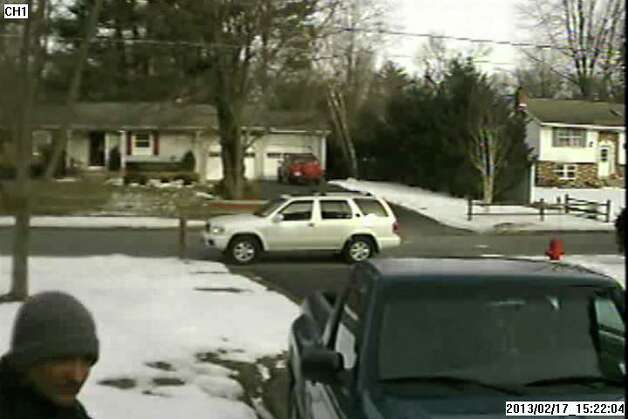 State troopers are trying to figure out who went to a man's Clifton Park home on Sunday and beat him with a pipe when he answered the door. State Police on Thursday released this  photograph that shows the suspect headed to a white Nissan Pathfinder parked at the end of the victim's driveway. (State Police)