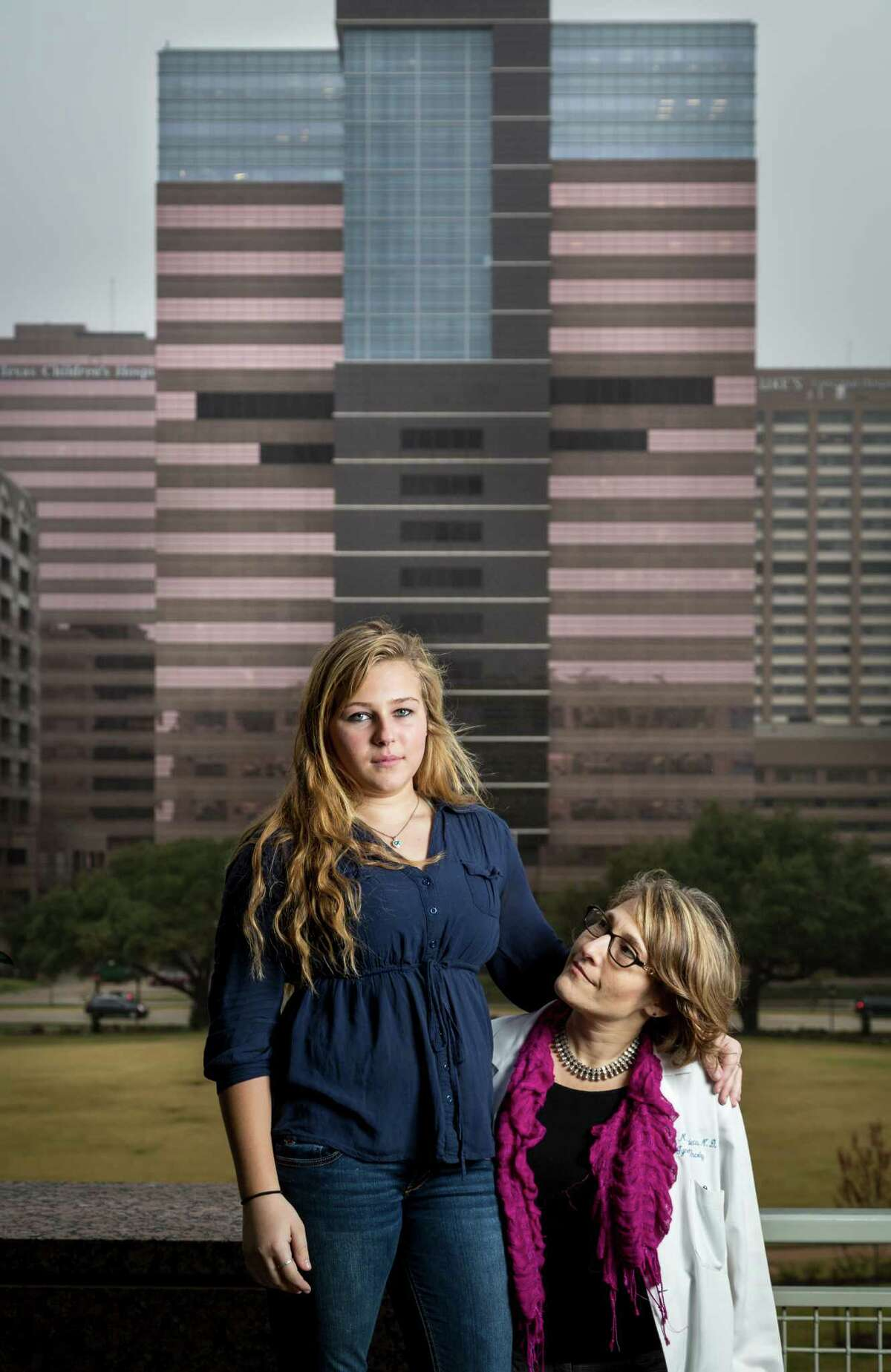 Dr. Lois Ramondetta and her daughter Jessica Bauer pose for a photo at MD Anderson's Ambulatory Clinic Building (Mays Clinic), Monday, Feb. 11, 2013, in Houston. ( Michael Paulsen / Houston Chronicle )