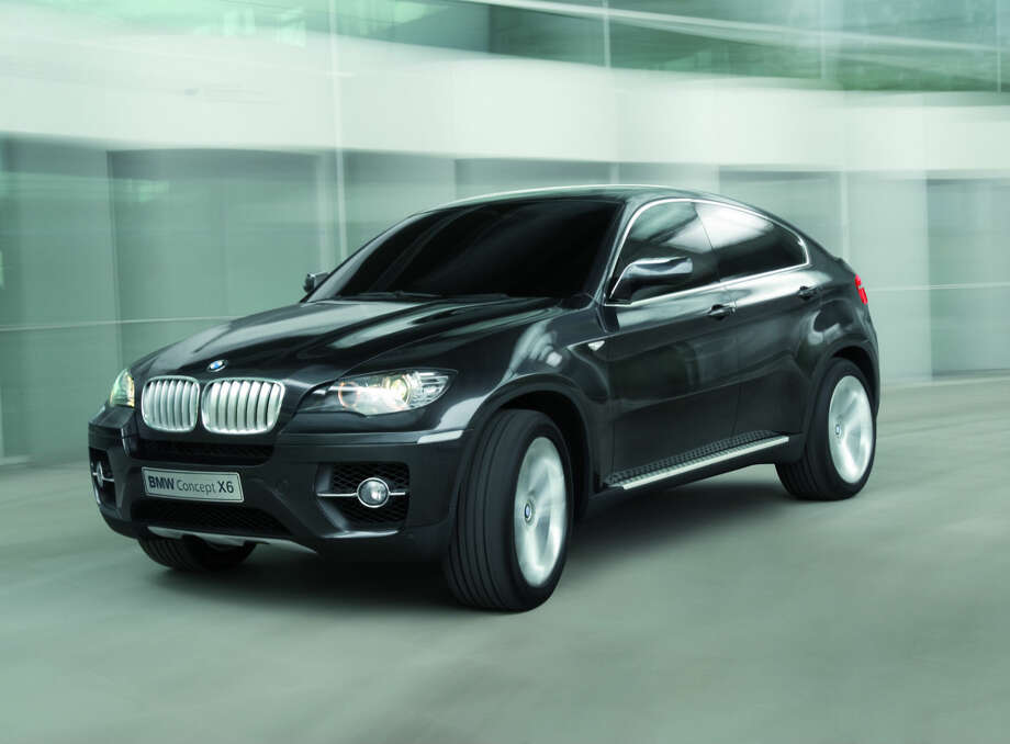 BMW Concept X6  debuted in 2007. This near-production concept car is the world's first ever Sports Activity Coupé. The concept study showcases BMW's vision for a unique vehicle concept that builds on the distinctive design idiom of the BMW X models while training the spotlight firmly on sportiness and an elegant presence. Photo: BMW
