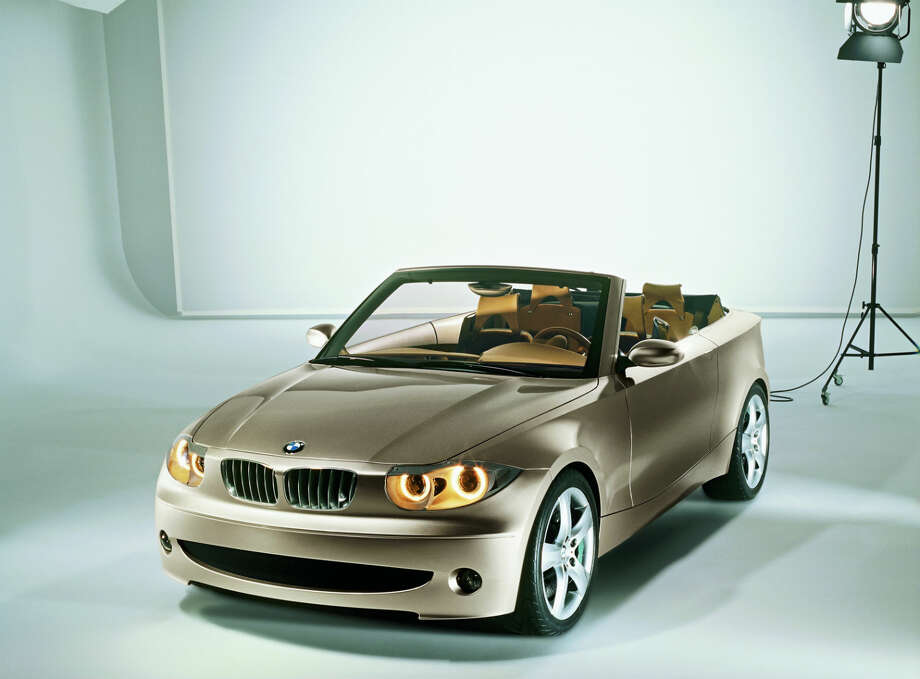 """BMW Concept Study CS1 debuted in 2002. This concept study is intended to offer a preview of a future """"small"""" BMW. The bond between elegant lightness and powerful dynamism is the defining element of the four-seater CS1 convertible study's design. A broad shoulderline, curving side sills and imposing wheels clearly announce its performance abilities and sturdiness. Photo: BMW"""