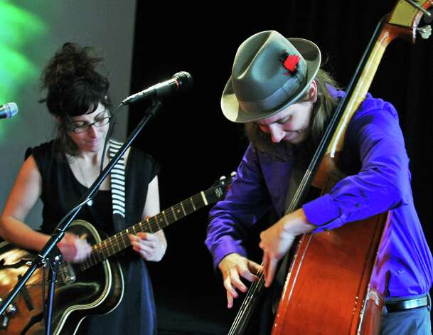 New blues duo Holly and Evan (Holly Taormina, left, and Evan Conway) perform during the First Night Saratoga  news conference in Saratoga Springs Wednesday Nov. 30, 2011. (John Carl D'Annibale / Times Union) Photo: John Carl D'Annibale / 00015557A