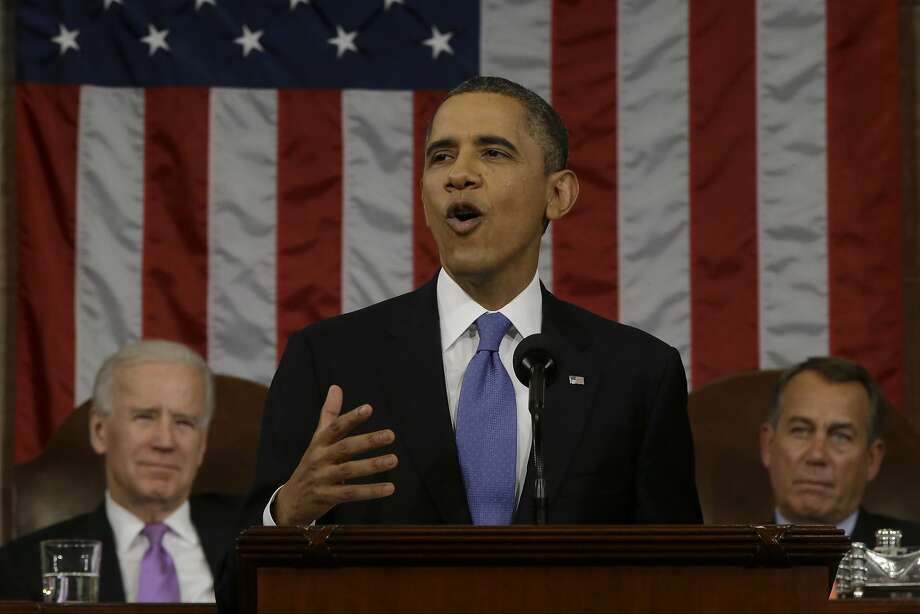 "U.S. President Barack Obama, center, delivers the State of the Union address to a joint session of Congress with U.S. Vice President Joseph ""Joe"" Biden, back left, and House Speaker John Boehner, a Republican from Ohio, back right, at the Capitol in Washington, D.C., U.S., on Tuesday, Feb. 12, 2013. Obama called for raising the federal minimum wage to $9 an hour and warned he'll use executive powers to get his way on issues from climate change to manufacturing if Congress doesn't act, laying out an assertive second-term agenda sure to provoke Republicans. Photographer: Charles Dharapak/Pool via Bloomberg *** Local Caption *** Barack Obama; Joe Biden; John Boehner Photo: Charles Dharapak, Bloomberg"