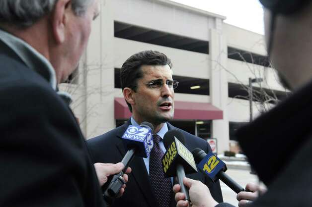 "WCBS-TV anchor Rob Morrison arrives at State Superior Court in Stamford, Conn., Tuesday, Feb. 19, 2013, faces charges including strangulation and disorderly conduct on his wife at their Connecticut home. The Morrisons said Monday the allegations are ""greatly exaggerated."" Their attorney says they're cooperating fully with authorities. Photo: Helen Neafsey / Greenwich Time"