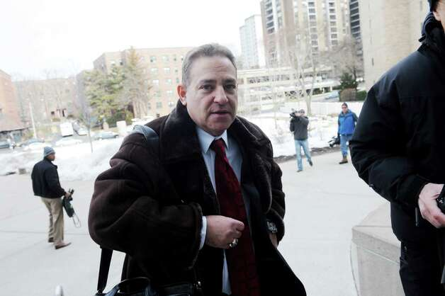 "Lawyer arrives at State Superior Court in Stamford, Conn., Tuesday, Feb. 19, 2013 arraignment. Rob Morrison faces charges including strangulation and disorderly conduct on his wife at their Connecticut. The Morrisons said Monday the allegations are ""greatly exaggerated."" Their attorney says they're cooperating fully with authorities. Photo: Helen Neafsey / Greenwich Time"