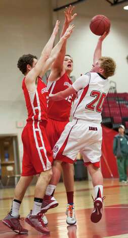 Greenwich high school's Jonathan Palmer and Alex Wolf stop New Canaan high school's Andrew Read from getting a basket in a boys basketball game played at New Canaan high school, New Canaan, CT on Monday February 18th, 2013. Photo: Mark Conrad / Stamford Advocate Freelance