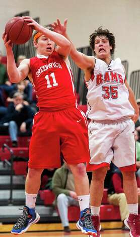 Greenwich high school's Alex McMurray and New Canaan high school's Beau Santero battle for a rebound in a boys basketball game played at New Canaan high school, New Canaan, CT on Monday February 18th, 2013. Photo: Mark Conrad / Stamford Advocate Freelance
