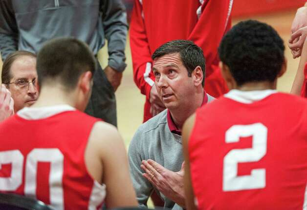 Bill Brehm, Greenwich high school boys basketball head coach, talks to his team during a timeout in a game against New Canaan high school played at New Canaan high school, New Canaan, CT on Monday February 18th, 2013. Photo: Mark Conrad / Stamford Advocate Freelance