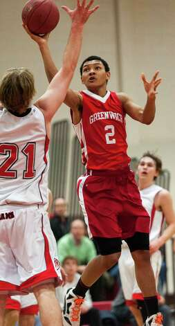 Greenwich high school's CJ Byrd goes up for a shot in a boys basketball game against New Canaan high school played at New Canaan high school, New Canaan, CT on Monday February 18th, 2013. Photo: Mark Conrad / Stamford Advocate Freelance