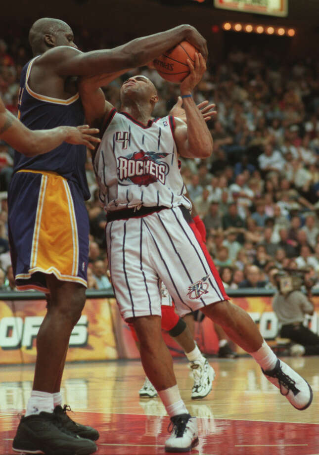 Barkley was never one to back down on or off the court. He once got in a tussle and body slammed Shaquille O'Neal in a 1999 matchup against the Lakers. Photo: KAREN WARREN, Houston Chronicle / Houston Chronicle