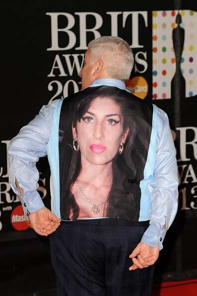 LONDON, ENGLAND - FEBRUARY 20: Mitch Winehouse wears a tribute to late daughter, Amy Winehouse, at t