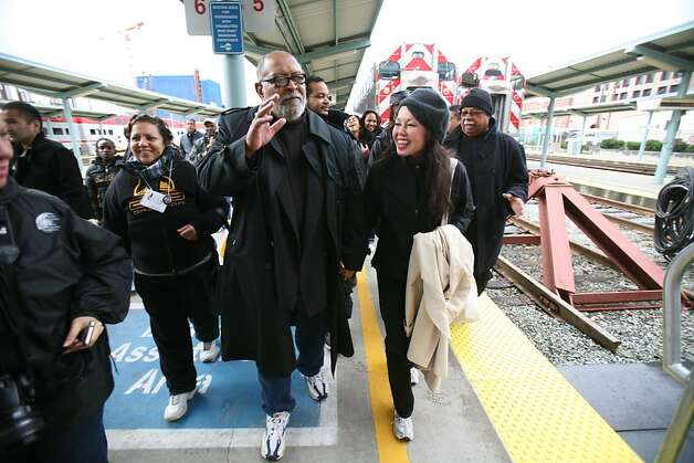 Cecil Williams and Janice Mirikitani (center) arrives on the Freedom Train at 4th and Townsend for the MLK Freedom March in 2008. Photo: Lea Suzuki, SFC