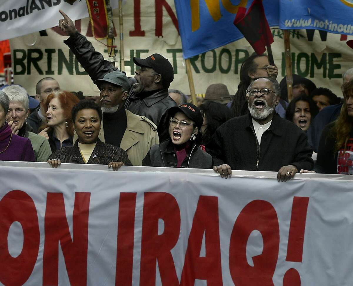 The big-name protestors leading the demosnstration are from left to right: Bonnie Raitt, Congresswoman Barbara Lee, actor Danny Glover, Janince Mirikitani, and Rev. Cecil Williams.