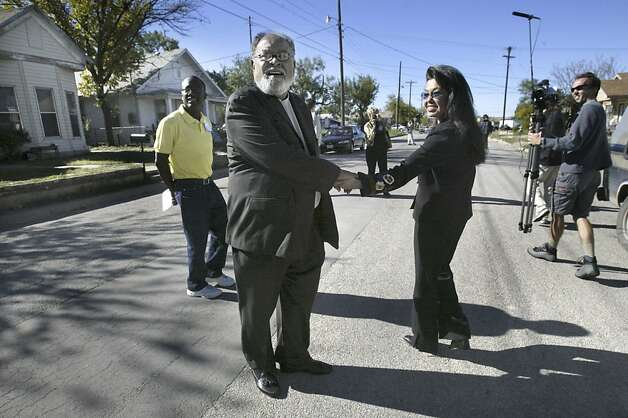 The Rev. Cecil Williams and his wife Janice Mirikitani (right) walk down 8th Street in San Angelo in 2002 after visiting the spot of his boyhood home. Rev Williams was turning around to look at the home of a former neighbor when he was a chid. Photo: Scott Sommerdorf, SFC