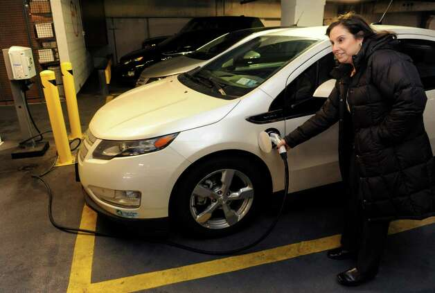 Lori Penchuk plugs in her Chevrolet Volt in the parking garage at Two Stamford Plaza on Wednesday, February 20, 2013. Photo: Lindsay Perry / Stamford Advocate