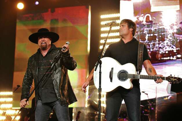 NASHVILLE, TN - JUNE 22:  Musicians Eddie Montgomery (L) and Troy Gentry of Montgomery Gentry perform onstage at Nashville Rising, a benefit concert for flood relief  at Bridgestone Arena on June 22, 2010 in Nashville, Tennessee.  (Photo by Fred Breedon/Nashville Rising/Getty Images for Nashville Rising) Photo: Fred Breedon / 2010 Getty Images