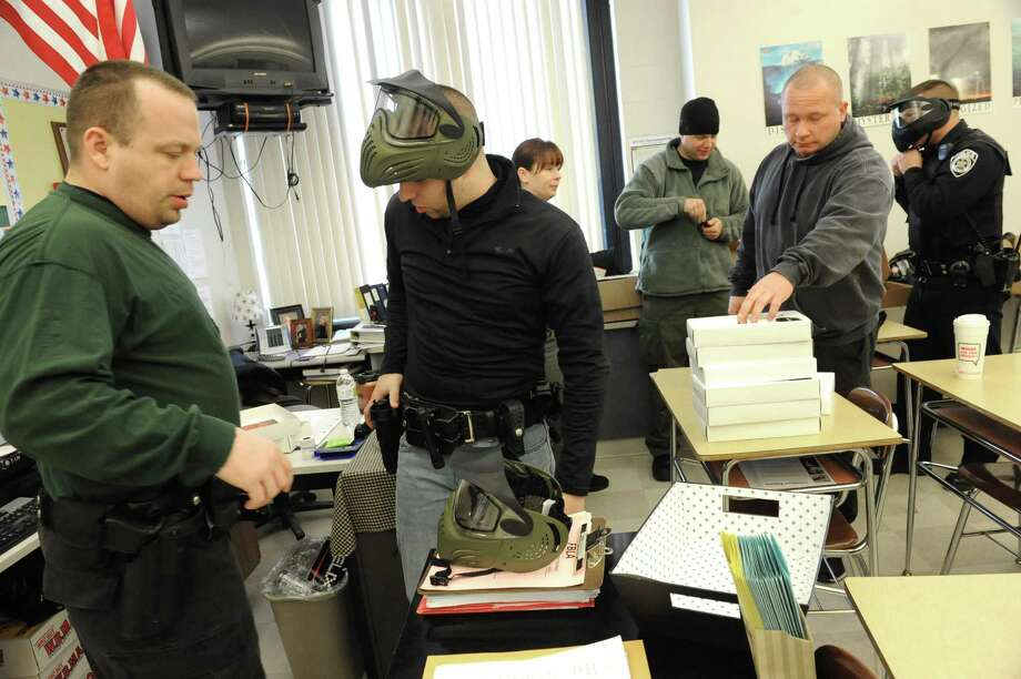 East Greenbush police officers suit up Wednesday during the department's ?active shooter? training class at Columbia High School in East Greenbush.  (Lori Van Buren / Times Union) Photo: Lori Van Buren