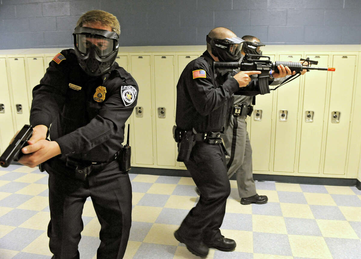 East Greenbush police officers run drills Wednesday in the hallways of Columbia High School in East Greenbush. The training was part of the police department's effort to prepare students for a shooting incident in places where there is a large gathering of people. (Lori Van Buren / Times Union)